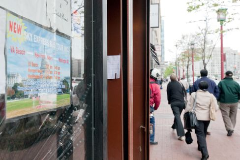 A sign for Sky Express hangs on a storefront window in Washington D.C., on Oct. 3, 2011. Photo: Christopher Powers/Bloomberg