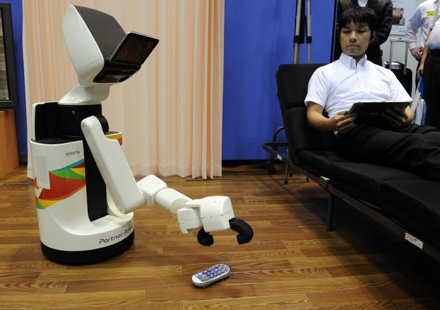 I'll let you handle the remote, but stay away from my grandmother.Photographer: Yoshikazu Tsuno/AFP/Getty Images