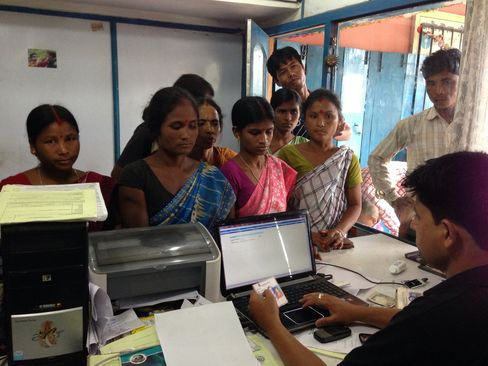 Customers Wait At A State Bank of India Kiosk