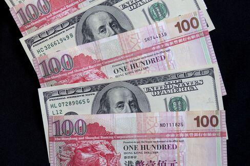 Ackman Won't Realize Bet on Hong Kong Dollar Peg, K.C. Chan Says