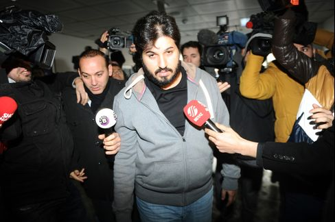 Riza Sarraf, center, is surrounded by journalists as he arrives at a police center in Istanbul, on Dec. 17. Photographer: Ozan Kose/AFP via Getty Images