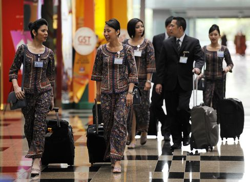 Singapore Airlines Flight Staff walk through Changi Airport