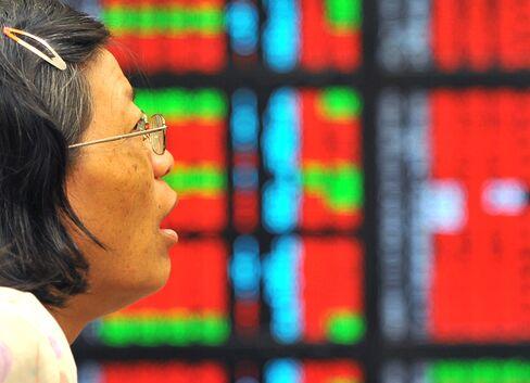 Taiwan's Stocks Gain as Government Panel Clarifies Trading Tax
