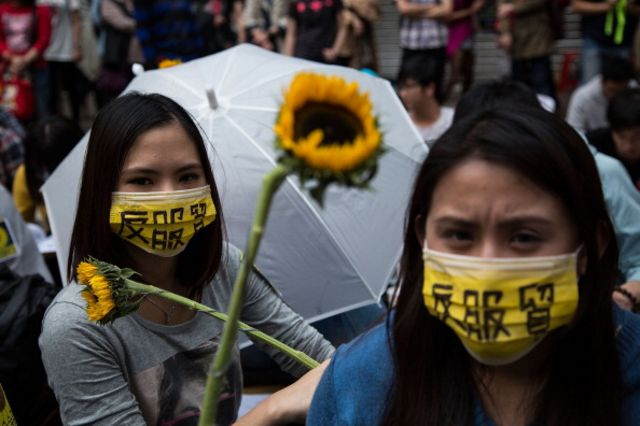 Is China scared of a few sunflowers? Photographer: Lam Yik Fei/Getty Images