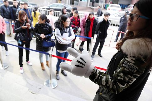 Applicants wait in line at a job fair for a chance to work at the Shanghai Disney Resort on March 2.