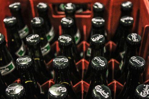 Crates of Bottled Carlsberg Beer Stand in Tastrup