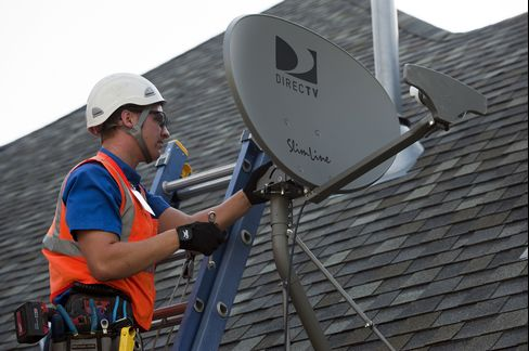 A DirecTV Employee Performs a Satellite Installation