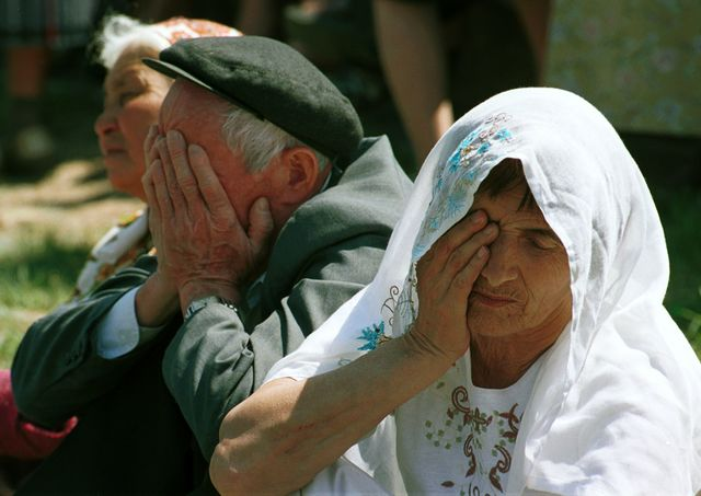 Crimean Tatars cry during a demonstration in 2003 marking the 59th anniversary of their mass deportation by Stalin's regime during World War II. Photographer: Sergei Svetlitsky/Getty Images
