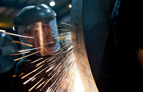 A grinding wheel is ues to assemble the bottom of a steel pole at the Rohn Products LLC manufacturing facility in Peoria, Illinois. Photographer: Daniel Acker/Bloomberg
