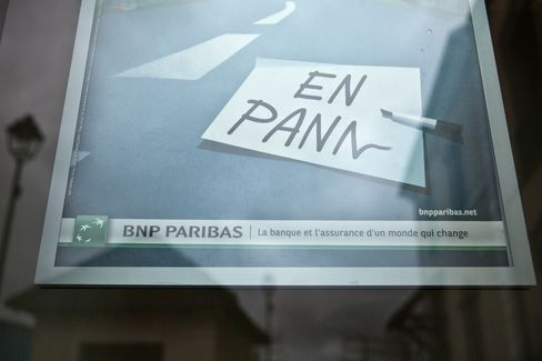 A BNP Paribas Poster Sits in Jouars-Pontchartrain