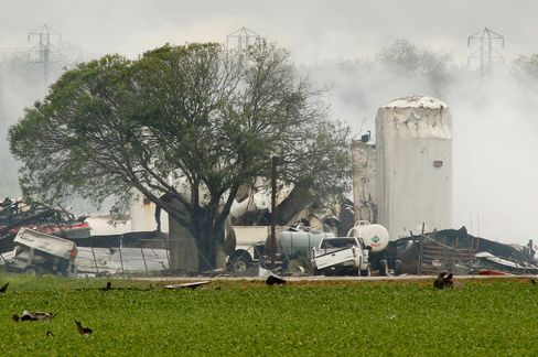 Debris litters fields around a fertilizer plant in West, Texas, on April 18, 2013. Much of the small town suffered damage when the plant caught fire causing a massive explosion Wednesday night. Photographer: Paul Moseley/Fort Worth Star-Telegram/MCT via Getty Images