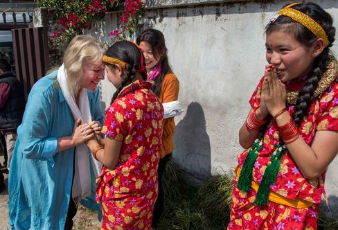 Exel, shown here with Nepalese girls in traditional dress, says,