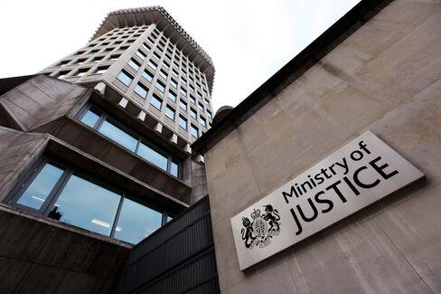Goldman, Law Firms Hire U.K. Lawyers, Prepare Bribery Act