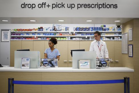 Pharmacy Employees Work at a Store in Louisville