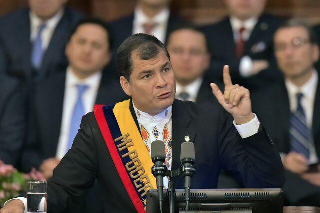 President Rafael Correa wants to keep his cool sash.Photographer: Rodrigo Buendia/AFP/Getty Images