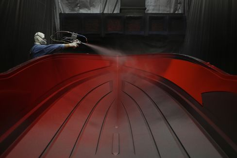 A Worker Applies a Gel Coat to an Inboard Speed Boat Mold