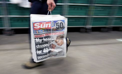Executive Editor at News Corp.'s Sun Faces Bribery Charges