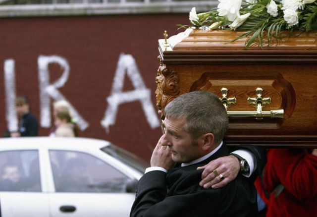 Michael McConville carries the remains of his mother Jean McConville to St Pauls church Oct. 1, 2003 in West Belfast, Northern Ireland.  Source: Getty Images