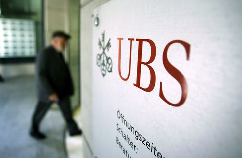 A visitor enters the headquarters of UBS AG in Zurich on Sept. 16, 2011. Photographer: Chris Ratcliffe/Bloomberg