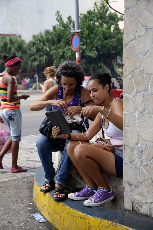 People gather within a government-provided Wi-Fi zone in Havana. For most Cubans, it's the only way to get online.