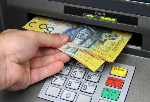 Top Forecaster Sees Aussie Below $1 on RBA Cut