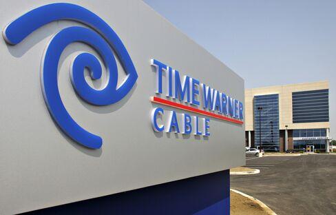 Time Warner Raises Forecast