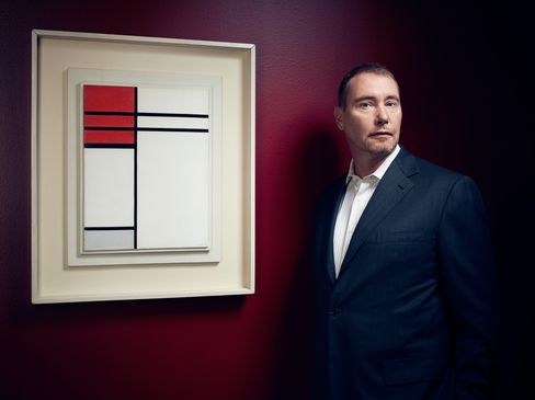 Jeffrey Gundlach, who sees bleak financial times ahead, is the co-founder of DoubleLine Capital. He stands by a painting by Piet Mondrian, whose double-line style inspired the firm's name. Photographer: Joe Pugliese/Bloomberg Markets