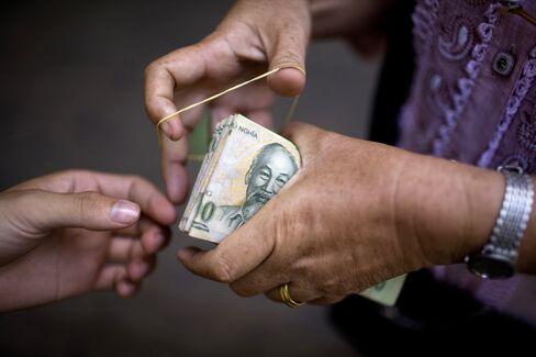 Vietnam Devalues Currency as Stock Market Declines