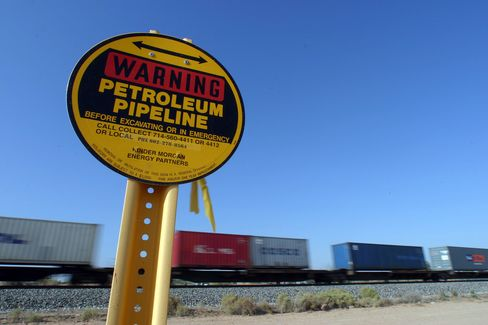 A pipeline owned by Kinder-Morgan along the Union Pacific Railroad line. Photographer: Tom Story/Bloomberg