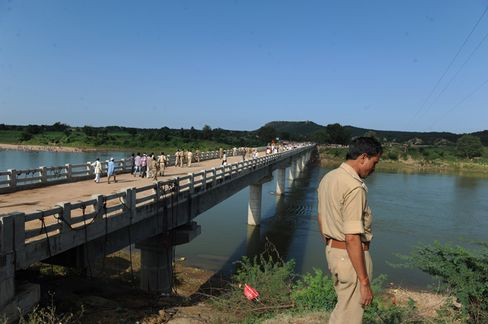 A Policeman Stands Next to the Bridge near the Ratangarh Temple