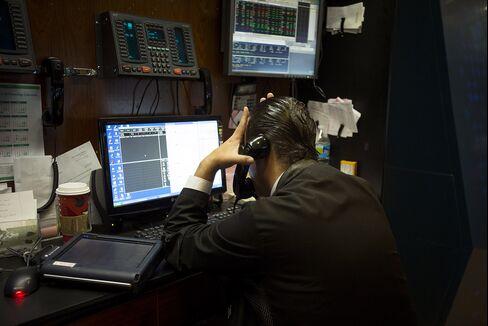 Tech Stocks Cheapest in Seven Years as Profit Estimates Decline