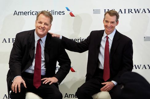 Doug Parker, chief executive officer of US Airways Group Inc., left, and Tom Horton, president and chief executive officer of AMR Corp.'s American Airlines, smile during a press conference at Dallas Fort Worth Airport on Thursday. Photographer: Mike Fuentes/Bloomberg