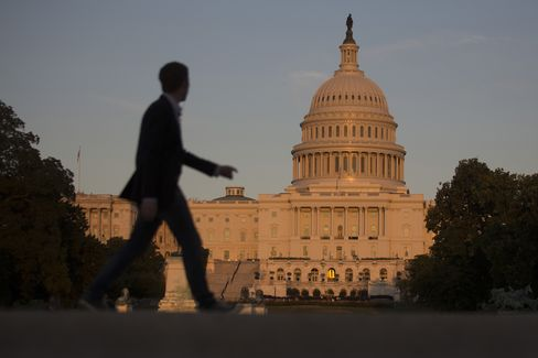 A Man Walks Past the U.S. Capitol in Washington, D.C.