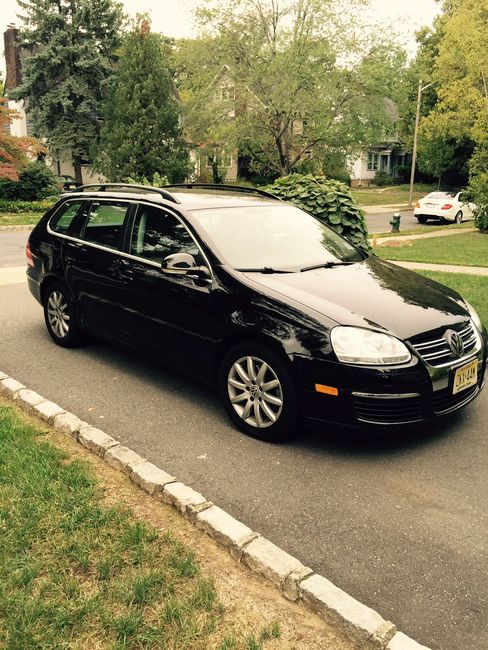 A portrait of the author's Jetta Sportwagen TDI, parked in a New Jersey driveway.