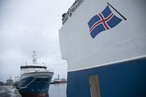 A national flag is seen on the hull of a commercial fishing vessel moored in the harbor in Reykjavik, Iceland. Photographer: Arnaldur Halldorsson/Bloomberg