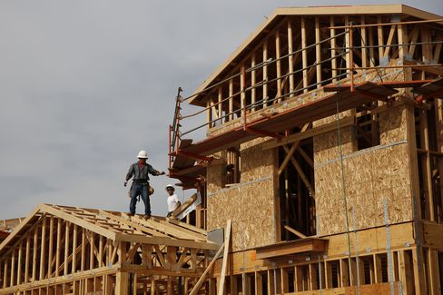 Workers Frame New Homes at a Development in Lake Forest