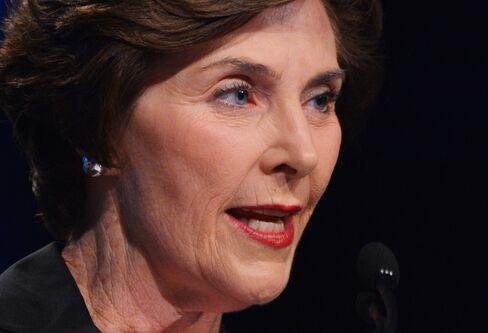 Laura Bush May Go Unpaid in Shutdown of Investing Seminar Firm