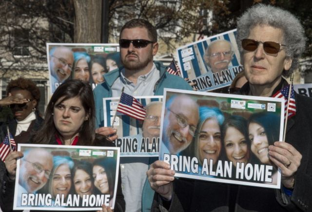 Supporters rally on behalf of Alan Gross across the street from the White House on Dec. 3. Photographer: Paul J. Richards/AFP/Getty Images