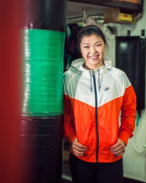 South Korea's Choi Hyun Mi, better known as ``Defector Girl Boxer,'' won the World Boxing Association featherweight title in 2008 and has successfully defended it since. She and her family fled North Korea in 2004 so she could develop her talent. Photographer: Dan Pak/Bloomberg Markets