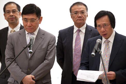 Sun Hung Kai Properties Ltd. Co Chairmen Raymond and Thomas Kwok