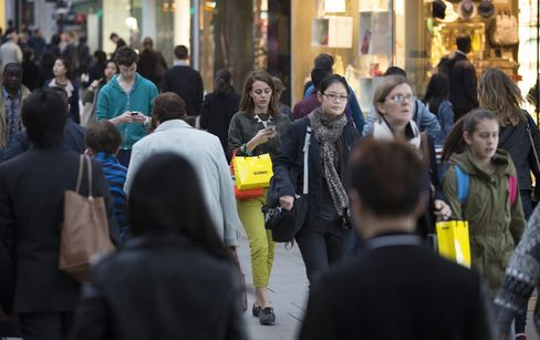 Pedestrians Carry Shopping Bags in London