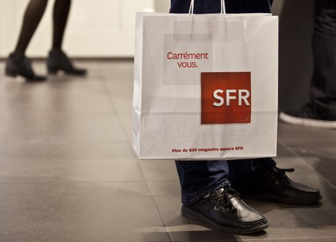 A Customer Carries a Shopping Bag inside an SFR Store