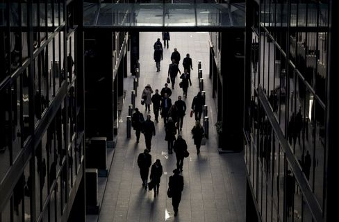 Pedestrians Walk Between UBS AG's Offices in London
