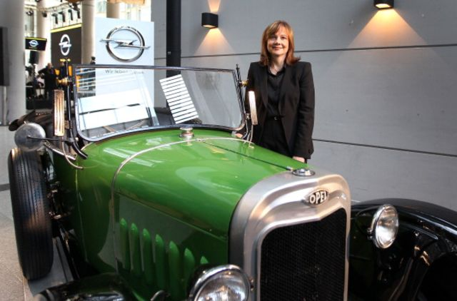 Mary Barra poses with a metaphor for GM's archaic culture. Photographer: Daniel Roland/AFP/Getty Images