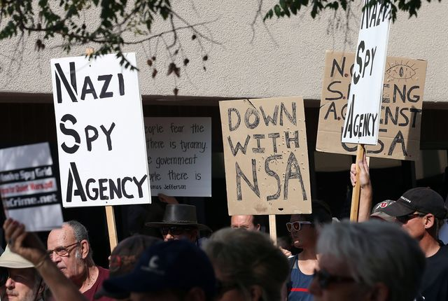 Protest signs aren't enough to keep the NSA's superpowers in check. Photographer: George Frey/Bloomberg