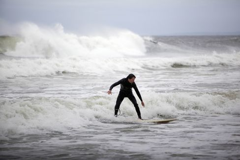 Hurricane Sandy Barrels North, Halts Travel, Forces Evacuations