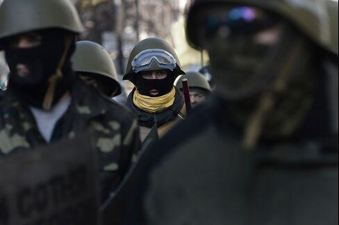 Anti-Government Protesters March in Kiev