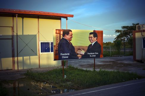 Venezuelan President Hugo Chavez shaking hands with Chinese President Hu Jintao marks the entrance to China Railway Engineering Corp.'s (CREC) Tinaco-Anaco railway project site in Los Dos,  Caminos, Venezuela, on Aug. 22, 2012. Photographer: Meridith Kohut/Bloomberg