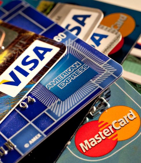 New laws could slash debit card revenue as much as 80 percent. Photographer: Daniel Acker/Bloomberg