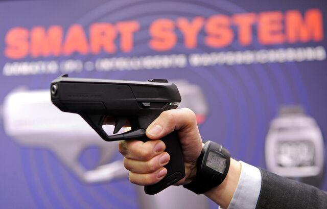 The wristwatch is what makesArmatix's guns so smart.Photographer: Joerg Koch/AFP/Getty Images